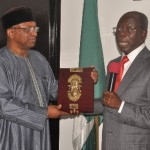 Governor Adams Oshiomhole of Edo State presents a souvenir to Dr Osagie Ehanire, Minister of State for Health, during the Minister's visit to the Governor in Benin City.